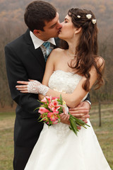 young wedding couple, beautiful bride with goom, autumn nature o