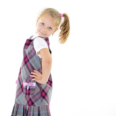 fashion little girl posing at studio over white