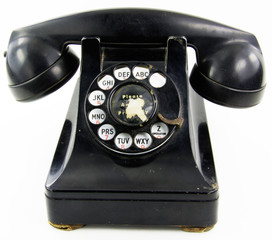 A black antique rotary phone on white background.