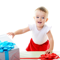 Holidays, baby girl reach for presents, christmas, birthday, new
