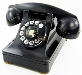 Retro rotary phone on white background.