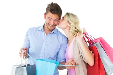 Attractive young couple holding shopping bags