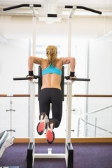 Rear view of fit woman doing crossfit fitness workout gym