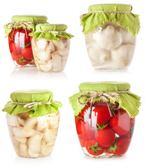 Canned tomatoes and garlic in glass jar isolated on white
