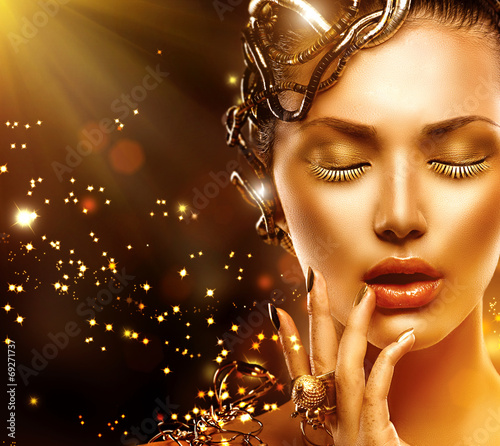 canvas print picture Model girl face with gold skin, nails, make-up and accessories