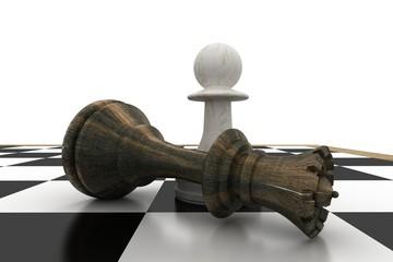 White pawn standing over fallen black queen