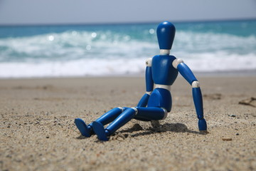 wooden figurine on beach