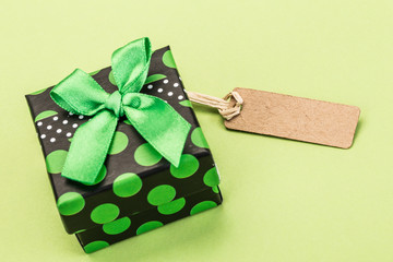 gift box with name tag, on green