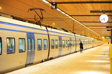 Commuter traing waiting at winter platform