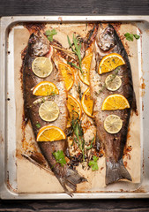 Fish Trout baked with orange, lime and herbs