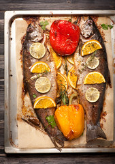 Trout fish baked with vegetables and herbs