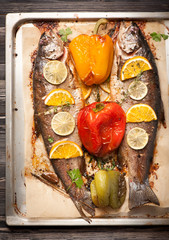 Baked trout fish with vegetables