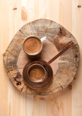 Coffee pot and cup coffee on wooden background
