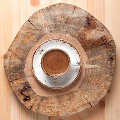 Espresso coffee on wooden board