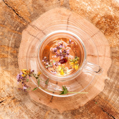 Herbal tea on wooden background