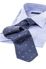 blue tie and shirt on white