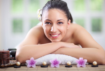 beautiful woman relaxing in spa center