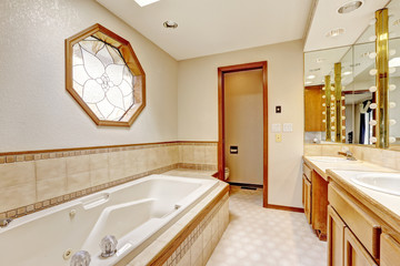Ivory bathroom interior with miriror and tile wall trim