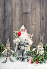 Santa Claus and happy kids in snow. Christmas decoration