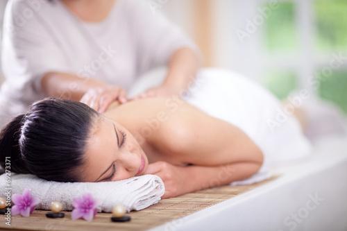 Beautiful woman having a wellness back massage - 69273371