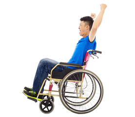 handicapped man sitting on a wheelchair and shouting