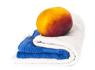 white and blue towels and mango
