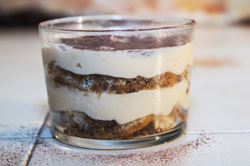 Traditional italian dessert tiramisu in a glass