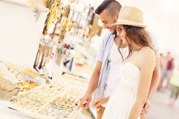 Young couple buying souvenirs