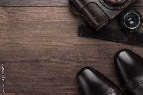 brown shoes and film camera background - 69274338