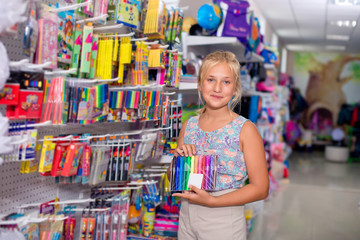 Schoolgirl buys exercise book Office goods in store for school