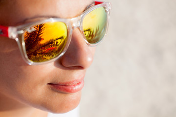 Woman In Sunglasses With Beach Reflection