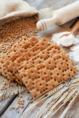 grain rye Crispbread, cereal crackers on rustic table