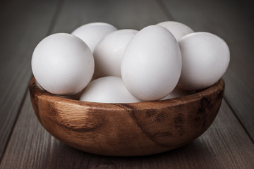 eggs in wooden bowl on the table