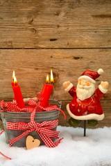 Postkarte - Adventskerzen mit Weihnachtsmann