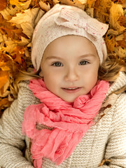 child lying autumn