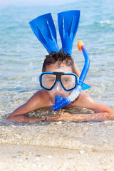 boy in the sea with diving mask