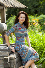 Beautiful young woman in colorful dress