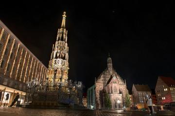 Schoener Brunnen am Hauptmarkt at night in Nuremberg