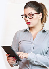 Young attractive businesswoman using tablet