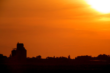 Sunset Sillouette with Grain Elevator