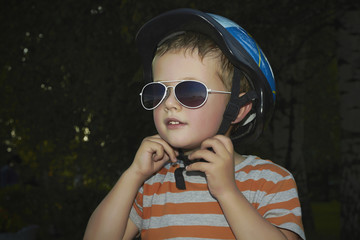 little boy in bicycle helmet.child in sunglasses.active life