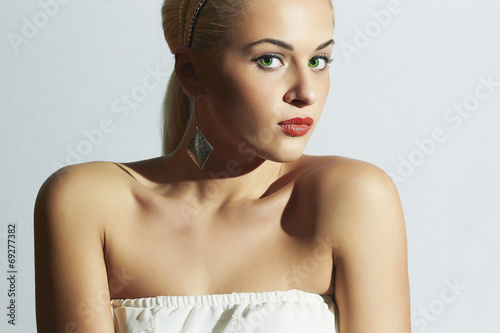 Beautiful woman in white dress.Fashion blond girl with red lips