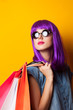 Women with violet hair with shopping bags.