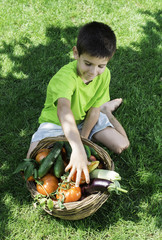 Child and basket with vegetables