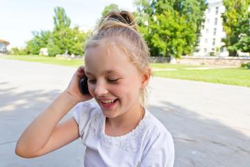 Cute girl talking by cellular