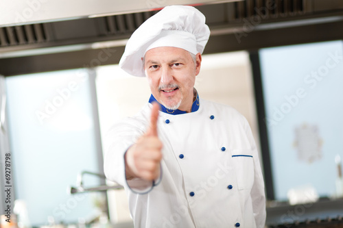 "Portrait of an experienced chef making ""OK"" sign"