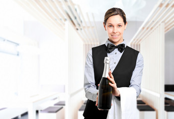 Waitress holding a bottle of champagne