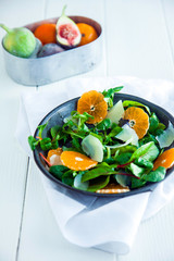 Healthy mache salad with oranges and parmesan