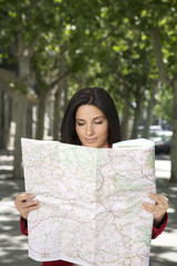 smiling woman watching a map