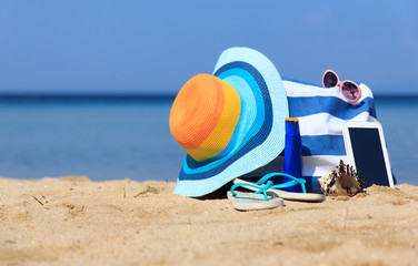 Colorful hat and bag on the beach